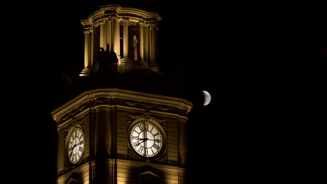 The supermoon next to the Polk County Courthouse in Des Moines.