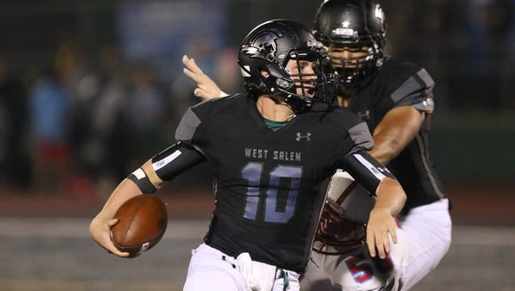 West Salem's Brody Wittman runs the ball as the Titans