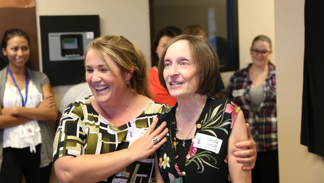 Debbie Justice, on the right, received an applause-filled farewell during her last day Monday as director of The Learning Center for families in St. George.