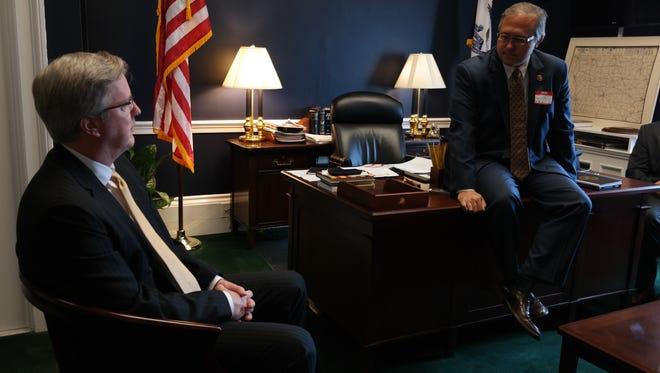 Iowa basketball coach Fran McCaffery, left, visits with Congressman David Young on Tuesday.