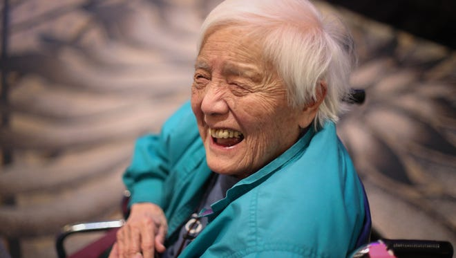 In this Feb. 25, 2014, photo, long-time activist Grace Lee Boggs speaks to a crowd gathered for the Environmental Grantmakers Association conference in Detroit. Boggs, known as an international activist for justice, has died at her Detroit home. She was 100. (Ryan Garza/Detroit Free Press via AP)