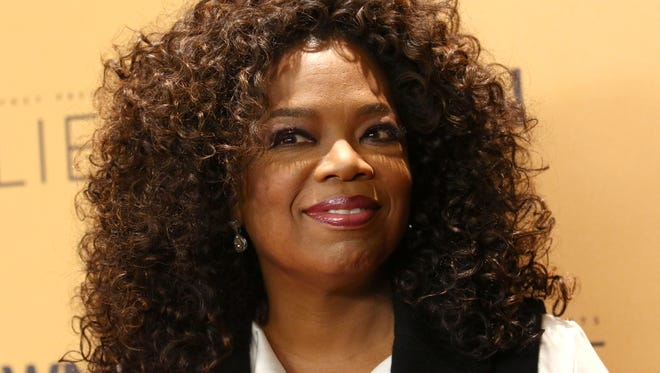 "FILE - In this Wednesday, Oct. 14, 2015, file photo, Oprah Winfrey attends the premiere of the Oprah Winfrey Network's (OWN) documentary series ""Belief,"" at The TimesCenter in New York. Weight Watchers announced Monday, Oct. 19, 2015, that Winfrey is taking an approximately 10 percent stake in Weight Watchers for about $43.2 million and joining the weight management company's board. (Photo by Greg Allen/Invision/AP, File)"