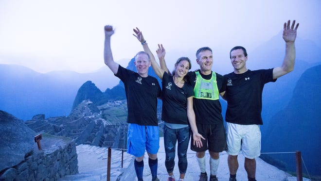 Dan Berlin, of Fort Collins, became the first blind athlete to run the Inca Trail to Machu Picchu in a single day. He's pictured here with his guide team, from left, Brad Graff, Alison  Qualter-Berna and Charles Scott.