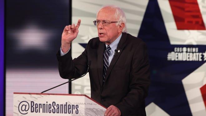 Vermont U.S. Sen. Bernie Sanders gestures while speaking at the Democratic presidential debate Saturday, Nov. 14, 2015, at Sheslow Auditorium on the campus of Drake University  in Des Moines, Iowa.