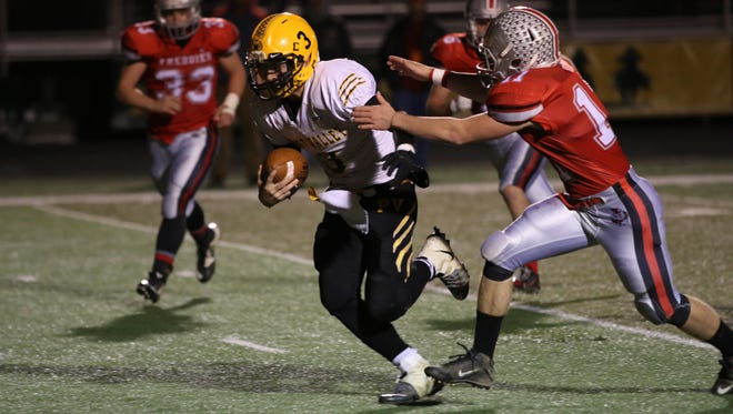 Paint Valley's Anthony McFadden carries the ball against Fredericktown during Saturday's Division VI regional semifinal at Hamilton Township High School. The Freddies beat the Bearcats 29-28.