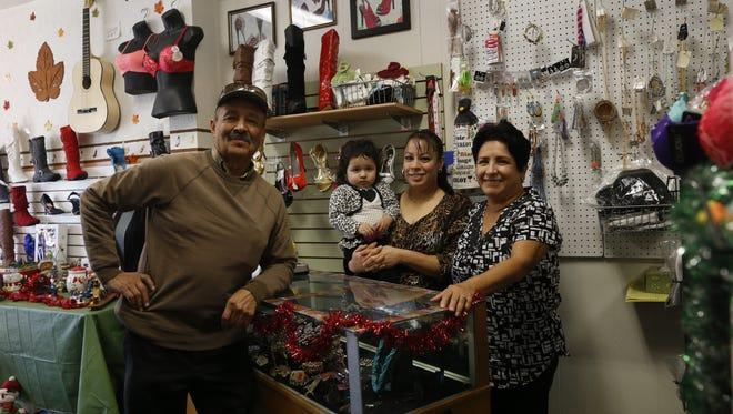 Oscar Rojas, left, Alexa Mercado-Hernandez, Alma Hernandez and Lupe Rojas pose for a portrait Thursday at Sahemi Shoes and More in Farmington.