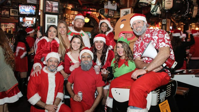 Hundreds of Santas, elves, reindeer, and other holiday characters invaded downtown Saturday night for the 3rd annual Santa Pub Crawl presented by O'Riley's Irish Pub.