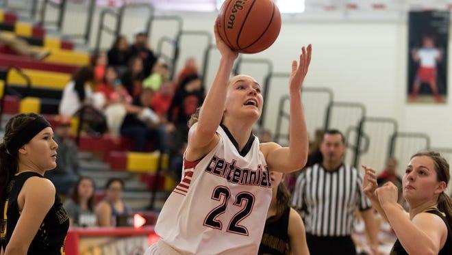 Centennial's Rylee Melon drives past Alamogordo defenders during Saturday's high school girls basketball game at Centennial High.