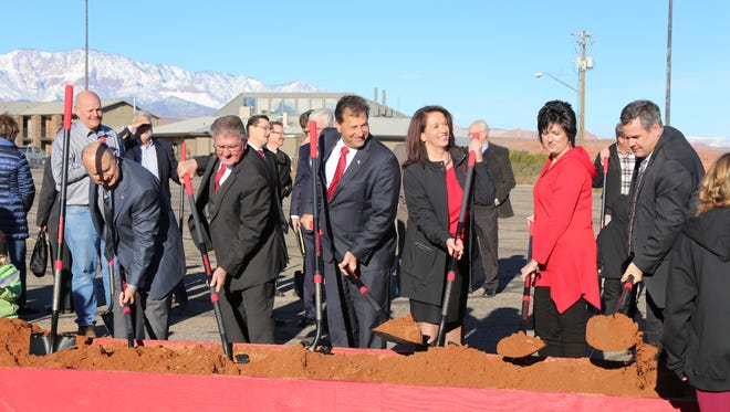 Dixie Applied Technology College President Kelle Stephens, third from right, joins St. George City Council dignitaries for groundbreaking ceremonies at DXATC's new campus on the Black Hill, Jan. 13, 2016.