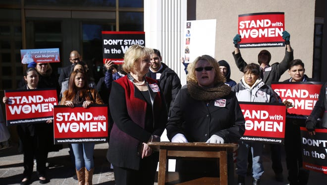 State Rep. Deorah Armstrong, D-Albuquerque, stands next to Diana Maze, a survivor of domestic violence, during a rally on Thursday at the state Capitol in Santa Fe.