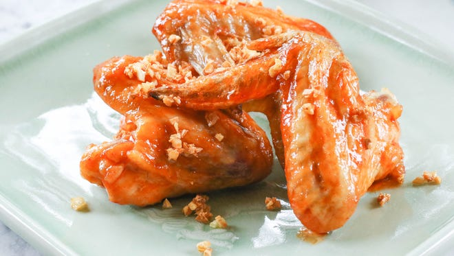 Chicken wings with Sriracha Agave Garlic sauce.