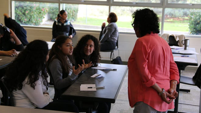 Middle school students speak with a CSUMB representative  at Wednesday's visit to campus.