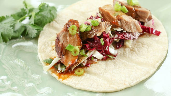 Peking Duck Tacos with Cilantro Lime Slaw.