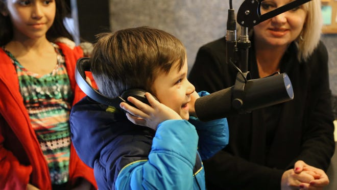 Five-year-old Leiren Nichols recites the pledge with Miranda in the Morning.