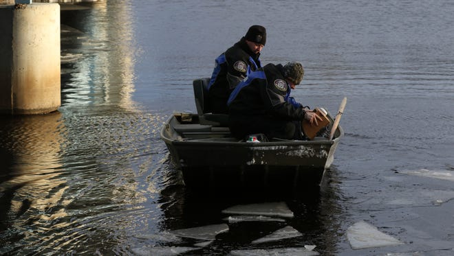 Wisconsin Department of Natural Resources Wardens search the Wisconsin River in Nekoosa after a 911 caller reported someone jumping from the Highway 73 bridge on February 9, 2016.