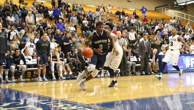 Josh James drives to the basket during overtime of Monmouth University's 82-75 win at St. Peter's University on Sunday afternoon