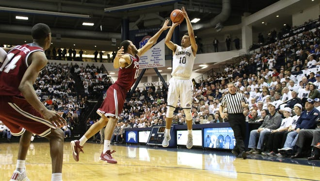 Micah Seaborn rises for a jumper over a Rider defender in the first half of Friday night's Hawks win, which secured the MAAC regular-season title