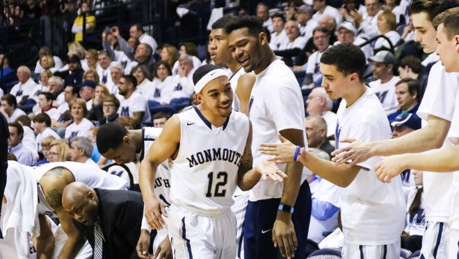 Justin Robinson leaves the floor in the closing minutes of Monmouth University's 79-58 win over Rider on Friday evening. The victory clinched at least a share of the MAAC regular-season title for the Hawks