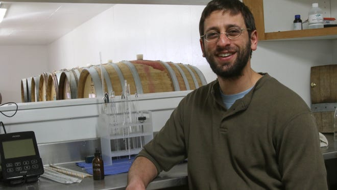 Gabriel Jagle is seen in the lab room at the winemaking facility at Scenic Valley Farms on Feb. 25.