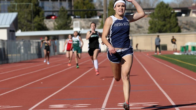 Piedra Vista's Cassandra Crowell crosses the finish line first with a time of 28.48 in the girls 200 meter dash on Saturday at the Farmington Invitational at Hutchison Stadium in Farmington.