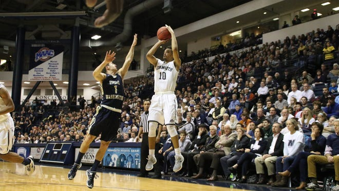 Micah Seaborn rises for a shot during the first half of Monmouth University's NIT matchup with George Washington on Monday evening