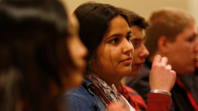 The audience listens to a presidential mock debate conducted by students Wednesday during the Kids Voting Mock Convention at the UW Center for Civic Engagement in Wausau.