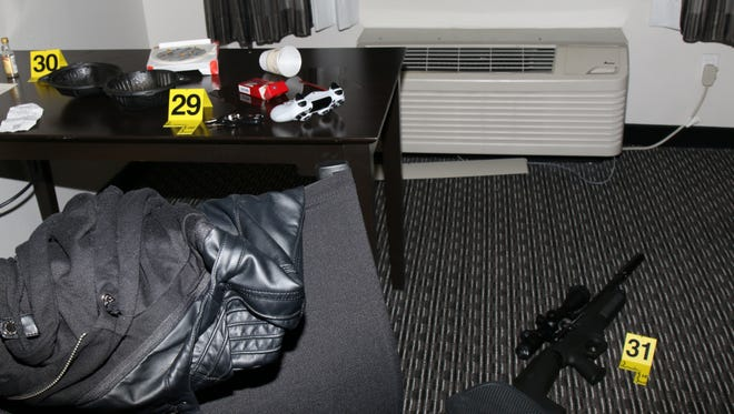 The inside of Daniel Shaver's hotel room shows a pellet gun, a set of vehicle keys and a whiskey bottle.
