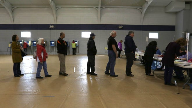 Marshfield area residents wait in line to be assigned a polling booth at the Oak Avenue Community Center in Marshfield on Election Day April 5, 2016.