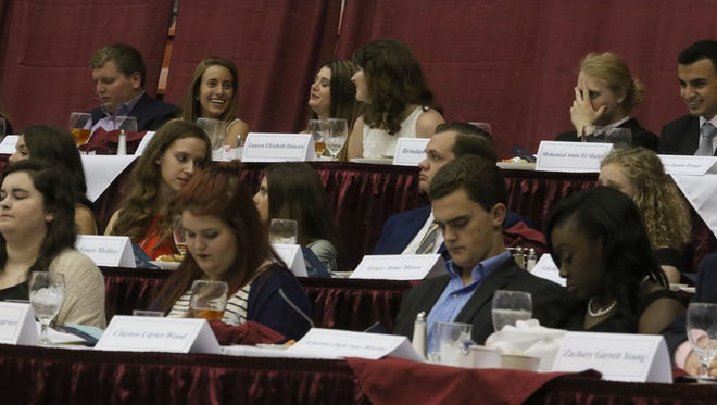 Local high school students wait to receive awards for their academic achievements during the Scholars' Banquet at the Monroe Civic Center on Monday.