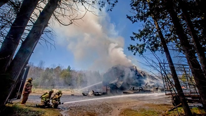 Firefighters from six departments battle a blaze on Bullock Road in Georgia on Friday.