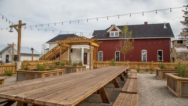 The Farmhouse restaurant's patio is used to host events including its Patio Party. The event was rescheduled and will be held on May 22, 2016 in Fort Collins.