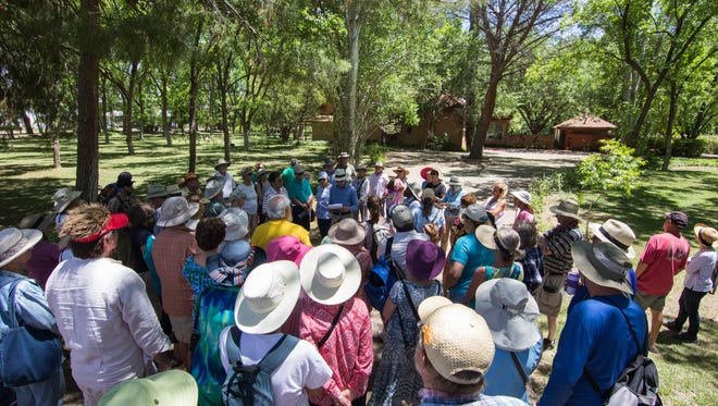 Participants on the Mesilla Park history tour stop in front of the historic George Bowman home to learn it's history as told by Dave Clements. (center in white hat)