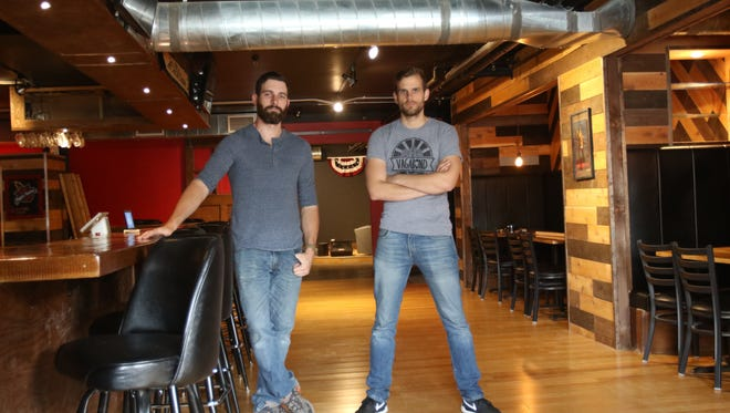 Vagabond Brewing co owners Dean Howes and Alvin Klausen are photographed in Victory Club, a new downtown taproom created by them and their Vagabond partner James Cardwell.