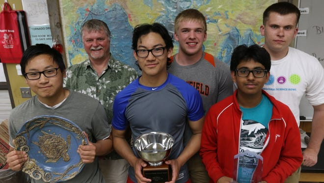 The Ocean Bowl team for Marshfield High School, from left, front to back: David Gui; Michael Gui, Suhaas Bhat, Paul Herder; teacher, Aaron Peters, Andrew Gilkerson, in their classroom May 25, 2016.