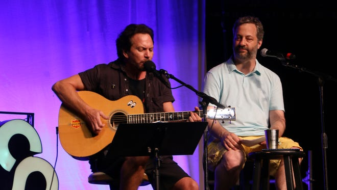 Eddie Vedder of Pearl Jam, left, and Judd Apatow sing a tribute for comedian Garry Shandling.