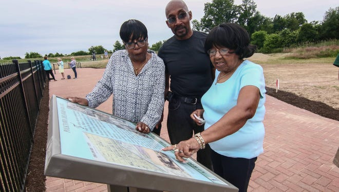 Joylette Carrington, right, the oldest resident of Polktown reminisces with her son and daughter Linda Price and Harry Portlock at Michael Castle Trail while visiting the African Union Church Cemetery near the trail, Wednesday, June 15, 2016, in Delaware City.