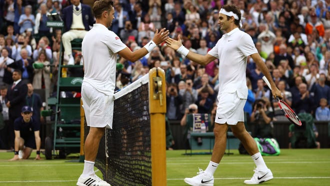 Marcus Willis of Great Britain and Roger Federer of Switzerland shake hands following the Men's Singles second round match on day three of the Wimbledon Lawn Tennis Championships at the All England Lawn Tennis and Croquet Club on June 29, 2016 in London, England.
