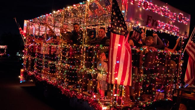 A patriotic float goes by at the Electric Light Parade on July 3, 2016.