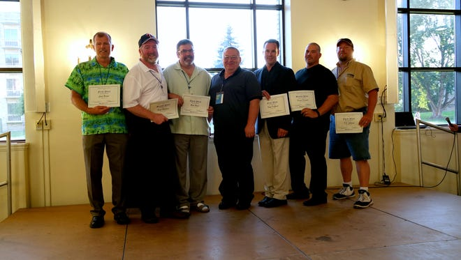Winners of the Minnesota Statewide Bus Roadeo pose for a photo. From left: Jack Berner, Paul Mattson, Rick Roser, Chris Daniels, Todd DeZurik, David Peacock and TJ Jackson.