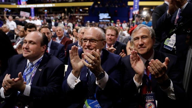 Former New York Mayor Rudy Giuliani cheers during the second day session of the Republican National Convention in Cleveland, Tuesday, July 19, 2016. (AP Photo/Matt Rourke)