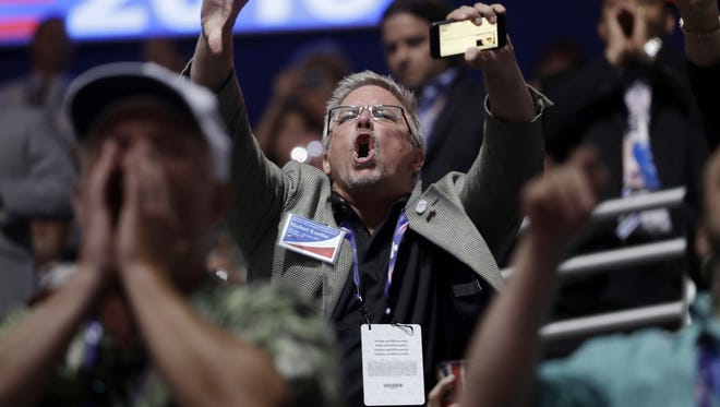 People react to Sen. Ted Cruz, R-Tex., as Cruz addresses the delegate during the third day session of the Republican National Convention in Cleveland, Wednesday, July 20, 2016. (AP Photo/Matt Rourke)