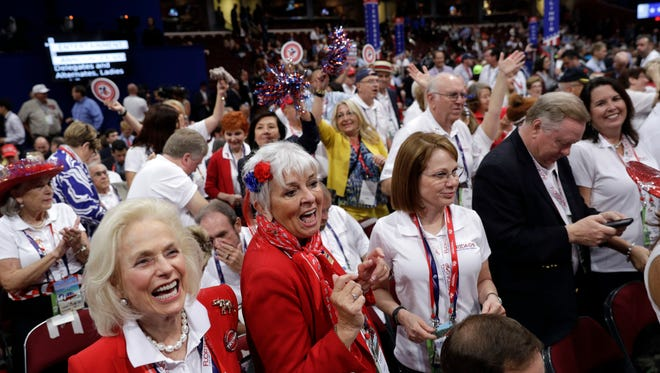 Florida delegates dance during the second day session of the Republican National Convention in Cleveland, Tuesday, July 19, 2016. (AP Photo/John Locher)