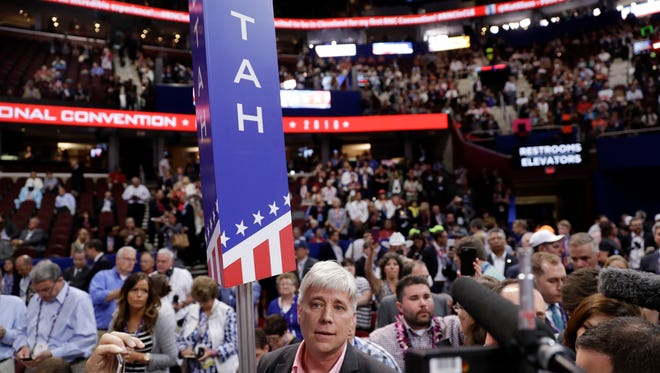 Utah delegate Phill Wright speaks as some delegates call for a roll call vote on the adoption of the rules during the opening day of the Republican National Convention in Cleveland, Monday, July 18, 2016. (AP Photo/Matt Rourke)