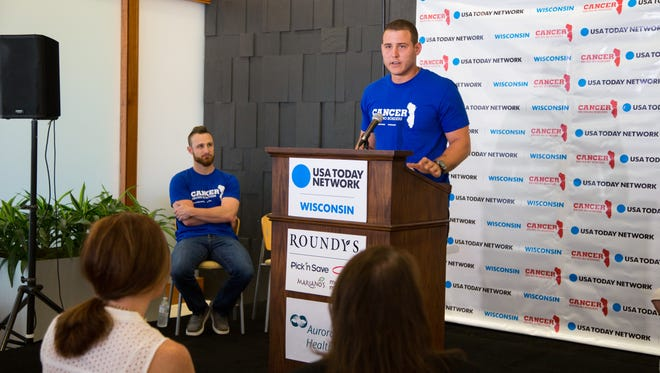 """Cubs first baseman Anthony Rizzo (right) and Brewers catcher Jonathan Lucroy (left) are teaming up for the """"Cancer Knows No Borders"""" campaign."""