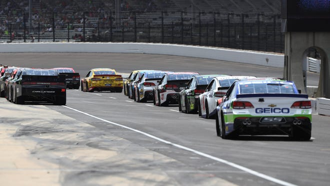 NASCAR Sprint Cup drivers line up to qualify for the Combat Wounded Coalition 400 at the Brickyard Saturday at Indianapolis Motor Speedway.