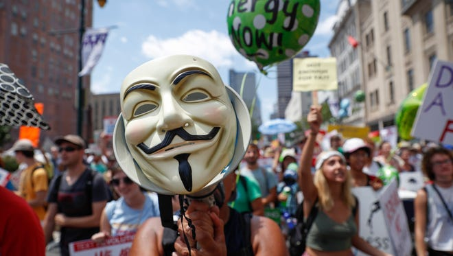 A protestor chants through a megaphone as he marches during a demonstration in downtown on Sunday, July 24, 2016, in Philadelphia. The Democratic National Convention starts Monday. John Minchillo photo