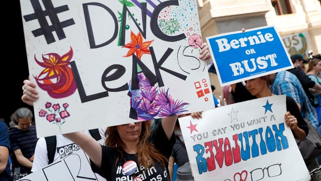 Demonstrators make their way around downtown, Monday, July 25, 2016, in Philadelphia, during the first day of the Democratic National Convention. On Sunday, Debbie Wasserman Schultz, D-Fla., announced she would step down as DNC chairwoman at the end of the party's convention, after some of the 19,000 emails, presumably stolen from the DNC by hackers, were posted to the website Wikileaks.