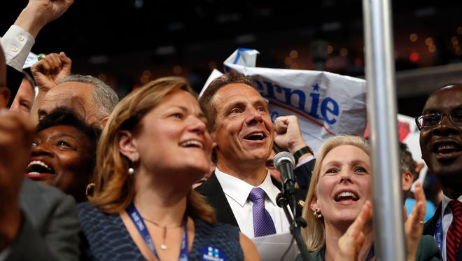 New York Gov. Andrew Cuomo and the delegates cast their votes for president Tuesday during the second day of the Democratic National Convention in Philadelphia.