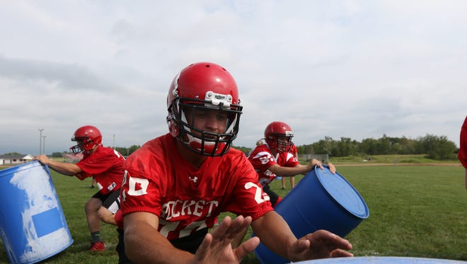 Spencer/Columbus players practice drills at Spencer High School during the first day of official practice, August 2, 2016.