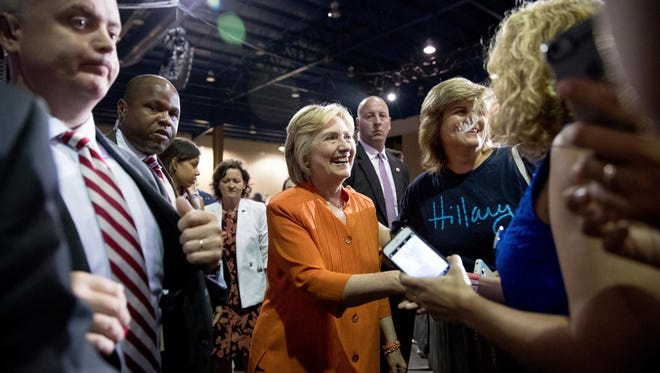 Democratic presidential candidate Hillary Clinton greets members of the audience after speaking at a rally at Osceola Heritage Park, in Kissimmee, Fla., Monday, Aug. 8, 2016.